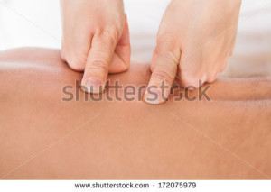 stock-photo-close-up-of-person-receiving-shiatsu-treatment-from-massager-172075979