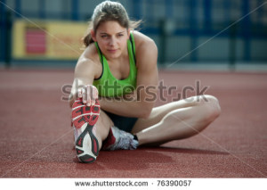 stock-photo-young-female-sprinter-stretching-76390057