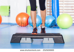 stock-photo-close-up-of-feet-in-step-equipment-at-gym-252928900
