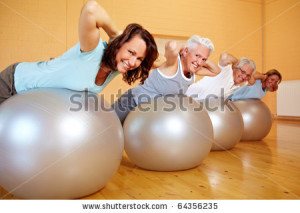 stock-photo-group-in-gym-doing-back-exercises-on-swiss-balls-64356235