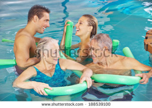 stock-photo-happy-group-in-swimming-pool-doing-aqua-fitness-with-swim-noodles-188539100